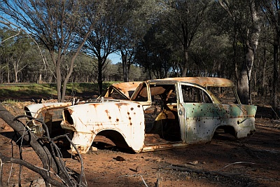 Rusty cars in the Australian Outback make for target practice