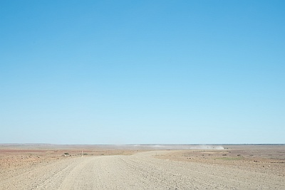 Dust on the road to Birdsville and The Big Red Bash