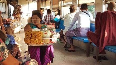 Food vendor in Myanmar wears Thanaka