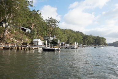 Dangar Island is lined with boatsheds and jettys