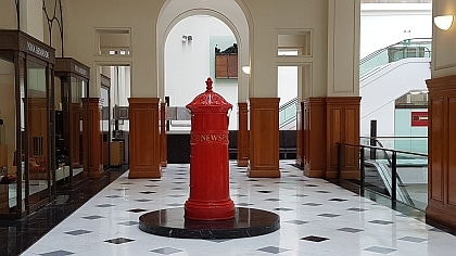 Early Red Post box reflects the history behind the Fullerton Hotel