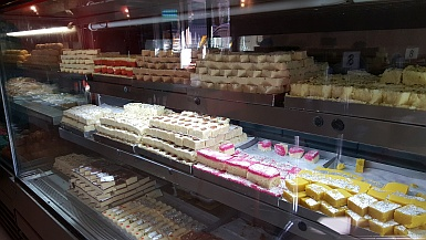 Shelves of Indian Sweets
