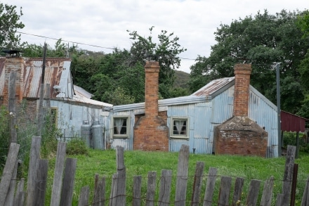 Cottages built from various materials survive in Hill End