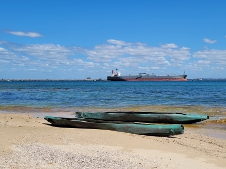 Nuwi canoe and tankers at Kurnell