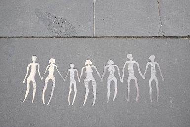 Figures in Melbourne sidewalk