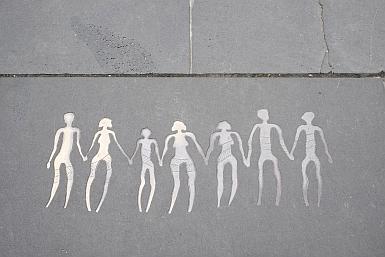 Figures in Melbourne sidewalk