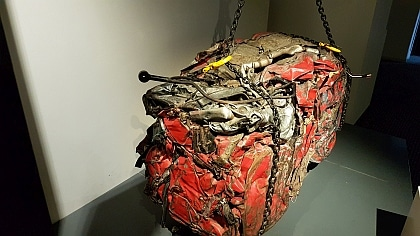 Metal from a crushed car can be recycled.