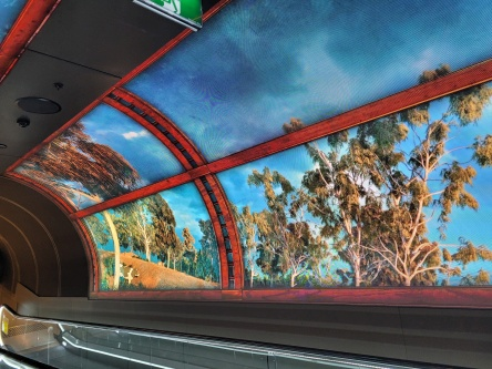 Moving Images on the Travelator leading from the car park to Romeo's IGA in South Eveleigh